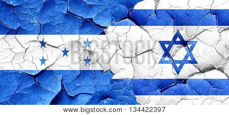 Honduras flag with Israel flag on a grunge cracked wall