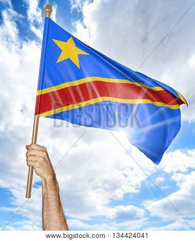 Person's hand holding the DR Congo national flag and waving it in the sky, part 3D rendering