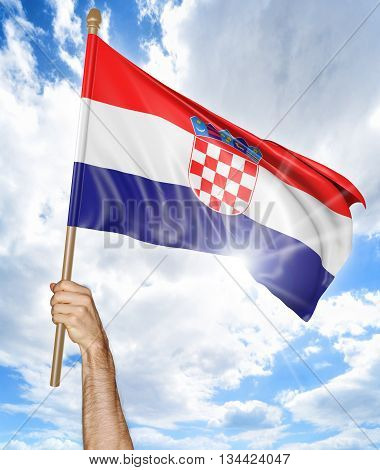 Person's hand holding the Croatian national flag and waving it in the sky, part 3D rendering