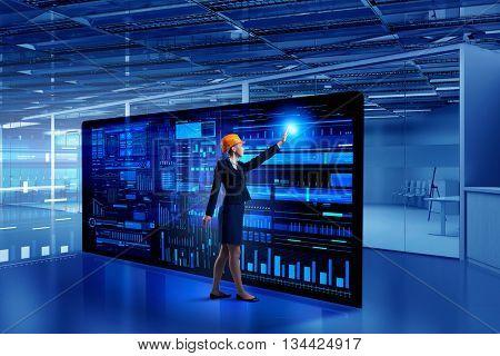 Engineer woman using virtual panel