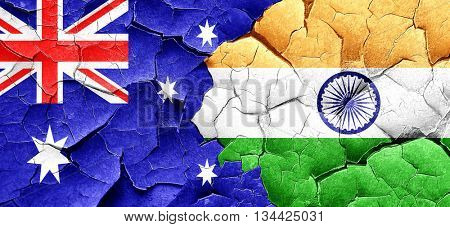 Australia flag with India flag on a grunge cracked wall