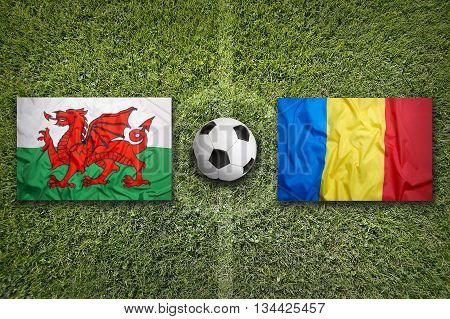 Wales Vs. Romania Flags On Soccer Field