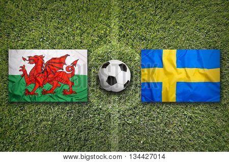 Wales Vs. Sweden Flags On Soccer Field