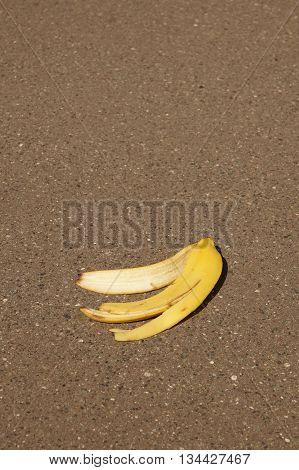 banana peel or banana skin lying on asphalt