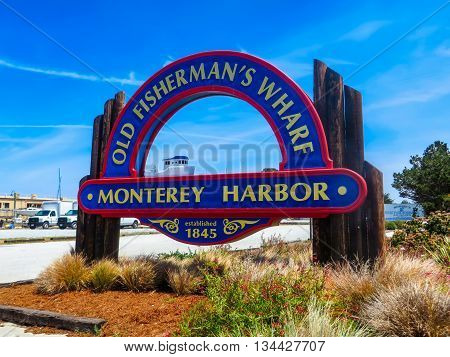 Monterey Harbor, California, USA - May 15, 2015: A sign showing Old Fisherman's Wharf by a car park in Monterey, United States of America