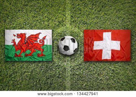 Wales Vs. Switzerland Flags On Soccer Field