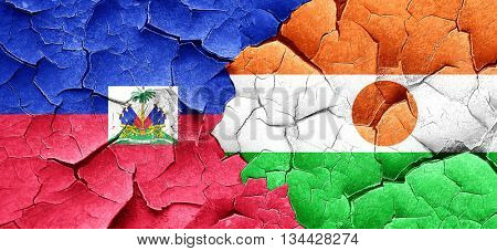 Haiti flag with Niger flag on a grunge cracked wall
