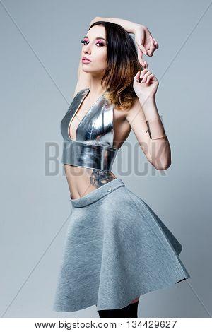 Cute Woman in futuristic creative metallic costume