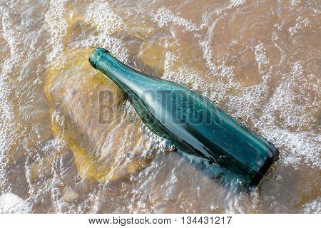 Green Bottle In A Murky Lake