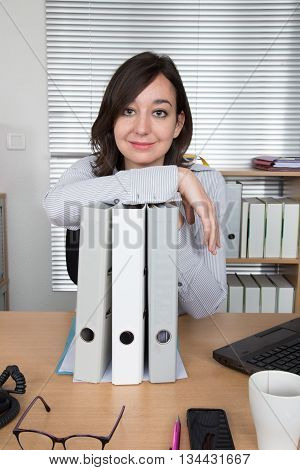 Smiling business woman with documents at office