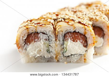 Roll made of Fresh Salmon, Cream Cheese and Cucumber inside. Topped with Smoked Eel (unagi)