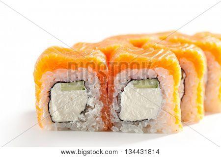 Philadelphia Maki Sushi made of Cream Cheese and Cucumber inside. Salmon outside