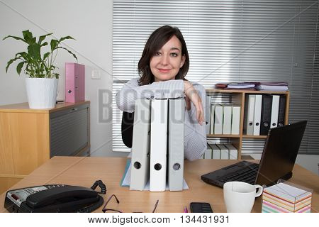 business woman with documents in her workplace
