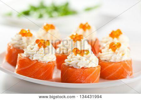 Maki Sushi - Philadelphia Roll made of Cream Cheese  inside. Fresh Raw Salmon outside