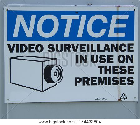 A sign warning of the presence of video surveillance equipment..