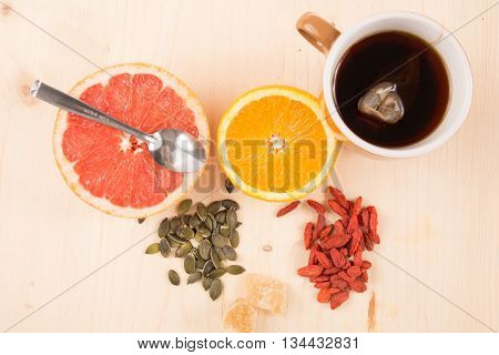 Healthy Breakfast With Fruits, Tea, Goji Berries, Seeds And Ginger