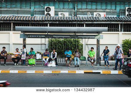 BANGKOK THAILAND - MAY 2 2016 : people wait the bus at bus stop near Huay Kwang market