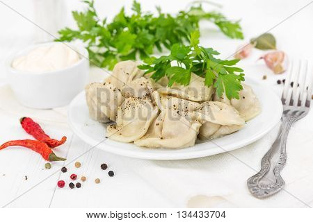 Boiled Meat Dumplings With Sprig Of Parsley In White Plate