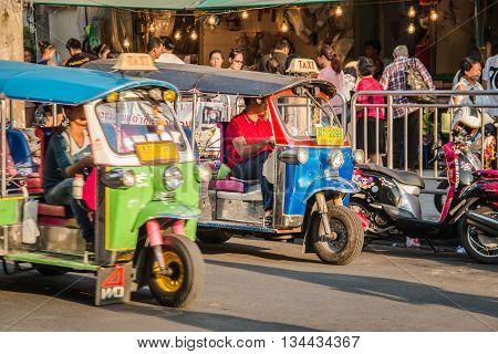 BANGKOK THAILAND - MAY 2 2016 : red blue thailand rickshaw tuk tuk taxi service at Huay Kwang market