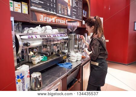 SAINT PETERSBURG, RUSSIA - CIRCA JULY, 2015: barista in Costa Coffee. Costa Coffee is a British multinational coffeehouse company. It is the second largest coffeehouse chain in the world