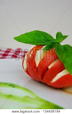 Caprese salad with mozarella cheese tomatoes and basil