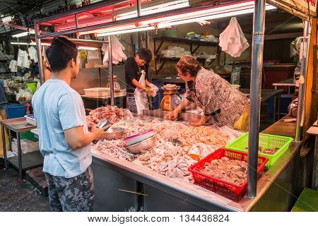 BANGKOK THAILAND - MAY 2 2016 : thai man buy fresh meat in Huay Kwang market bangkok