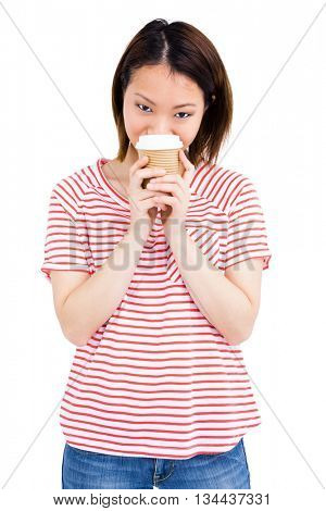 Portrait of a happy woman holding disposable coffee cup on white background