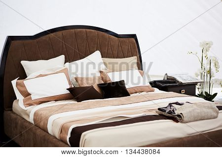 Interior of a bedroom in brown tones. Modern classics