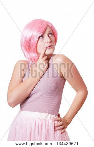 cute girlish young woman dressed in pink thinking or considering an idea