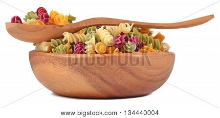 Colored Uncooked Italian Pasta Fusilli In A Wooden Bowl On A White