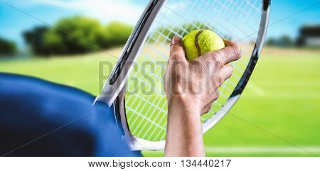 Tennis player holding a racquet ready to serve against composite image of soccer field