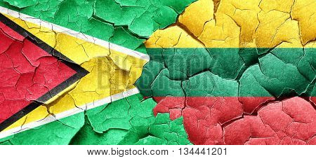 Guyana flag with Lithuania flag on a grunge cracked wall