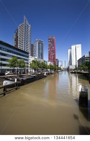 Old barges and modern buildings in Rotterdam