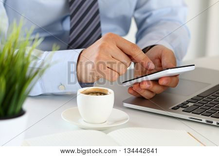 Close up view of businessman hands holding smart phone. Mobile applications playing games social media organizing work online banking or purchase concept.