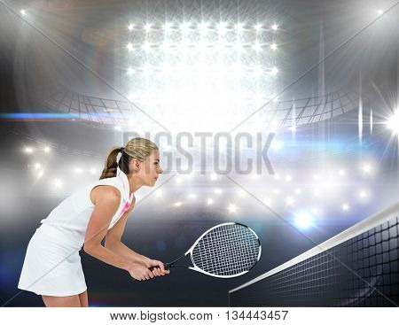 Athlete playing tennis with a racket against american football arena