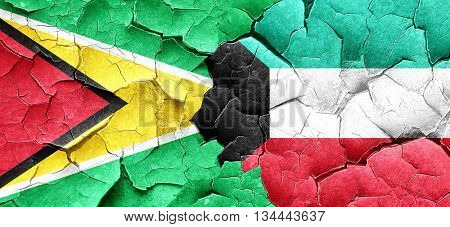 Guyana flag with Kuwait flag on a grunge cracked wall