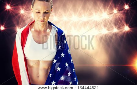 Portrait of american sportswoman unsmiling against flash light