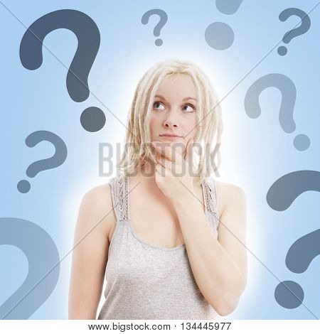 young woman with blonde dreadlocks thinking with question marks