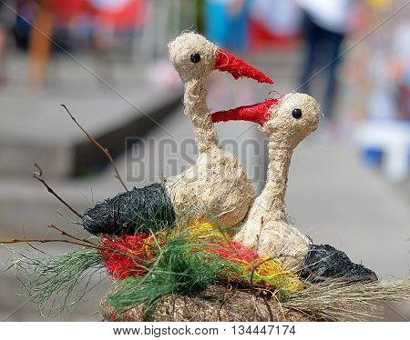 Bydgoszcz, Poland - June 05, 2016 Handmade figurines pairs of storks from the stand at the Fair regional Bydgoszcz.
