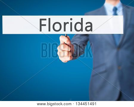Florida - Businessman Hand Holding Sign