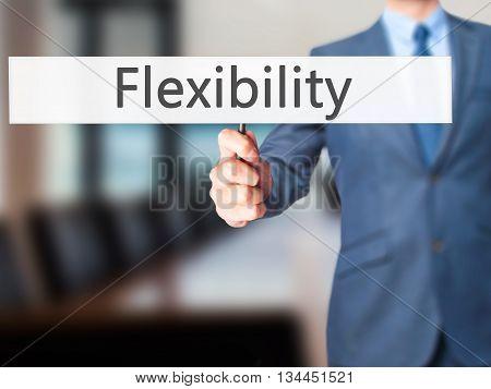 Flexibility - Businessman Hand Holding Sign