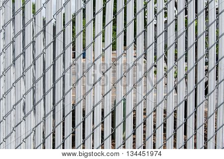 Chainlink Fence with Slats in front of parking lot