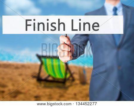Finish Line - Businessman Hand Holding Sign