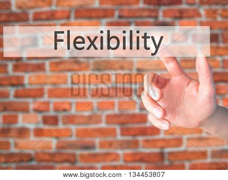 Flexibility - Hand Pressing A Button On Blurred Background Concept On Visual Screen.
