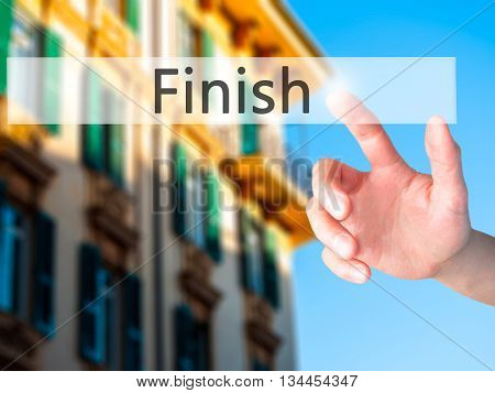 Finish - Hand Pressing A Button On Blurred Background Concept On Visual Screen.