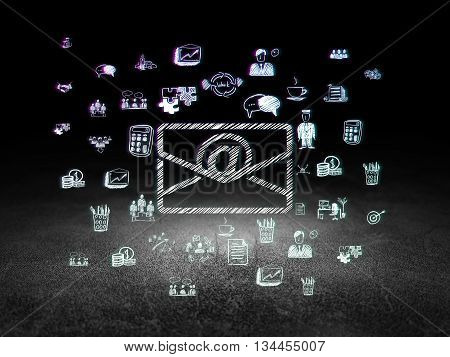 Finance concept: Glowing Email icon in grunge dark room with Dirty Floor, black background with  Hand Drawn Business Icons