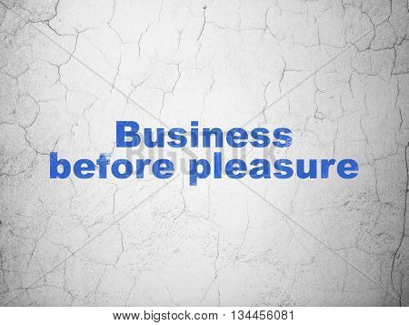 Finance concept: Blue Business Before pleasure on textured concrete wall background
