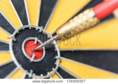 Closeup dart target with arrow on bullseye Goal target success business investment financial strategy concept abstract background