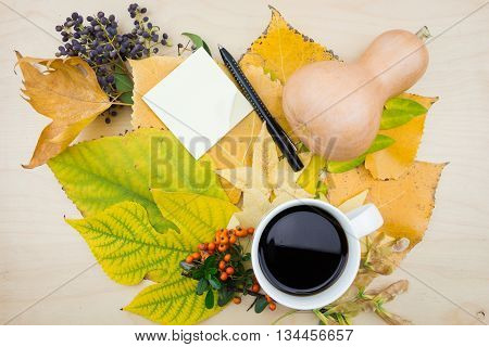 A Bouquet Of Yellow, Green Autumn Leaves With Coffee And Blank Note
