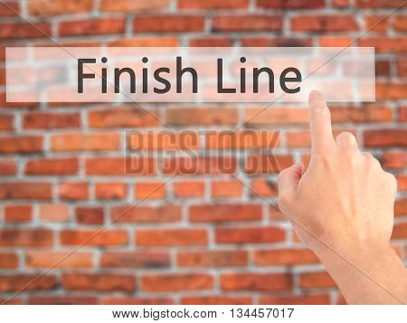 Finish Line - Hand Pressing A Button On Blurred Background Concept On Visual Screen.